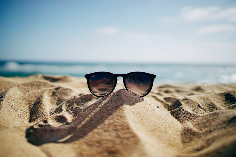 Sunglass on Sunny Beach for Travel